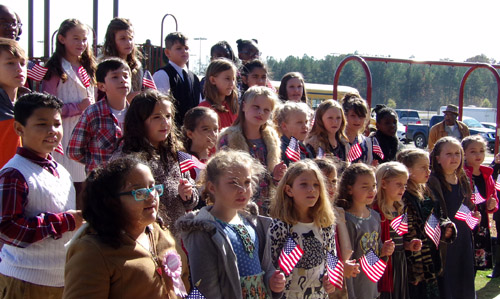Ripley Elementary students singing the National Anthem and America the Beautiful during Veterans Day 2017 at TIppah County Veterans Memorial