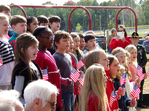 Students from Ripley Elementary School sing America the Beautiful.